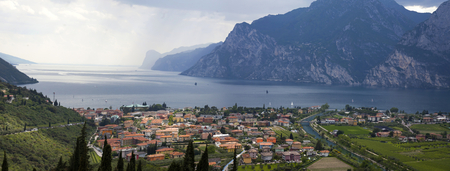Panoramic view of Garda Lake and the small town of Nago-Torbole