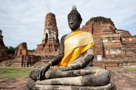 Ruins of Buddha statues and pagoda in Wat Mahathat, the old Thai temple inside Ayutthaya historical park, Thailand