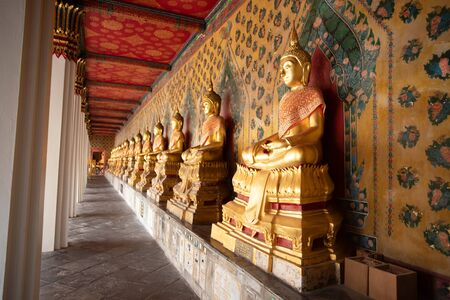 Row of Golden Buddha in Thailand. Golden Buddha statues at Temple of the Emerald Buddha, Wat Phra Kaew.