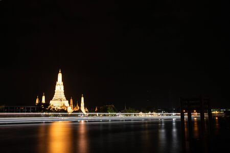 Night time view of Wat Arun Temple in Bangkok, Thailand.