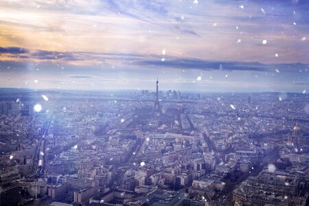 Scenic view to the Eiffel tower on a day with heavy snow. Christmas, holiday in Paris concept.