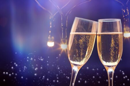 Champagne glasses on sparkling holiday background - Celebrating the New Year