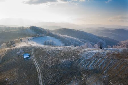 Aerial view of idyllic winter landscape with frozen trees in Transylvania. Winter is coming concept.