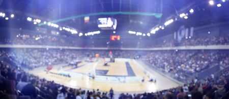 Blurred sports arena and fans during a basketball game