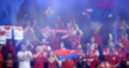 Blurred background of crowd of people in a basketball court Banque d'images