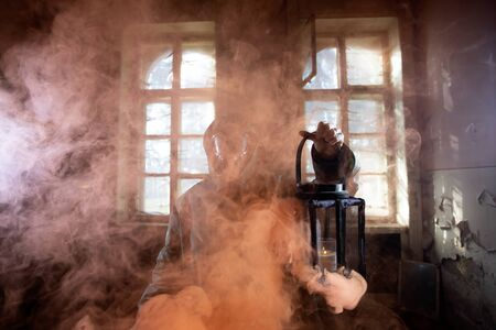 Post apocalyptic survivor in gas mask in the smoke. Environmental disaster, armageddon concept. Stock Photo