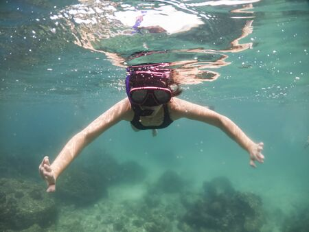 Women snorkeling in the tropical sea. Traveling, active lifestyle concept.