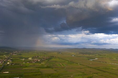 Dramatic sky with thunderstom over small village in Transylvania.