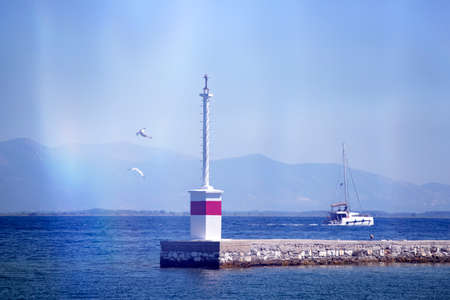 Greek specific - Sea mark with boat and flying seagulls in the Aegean Sea