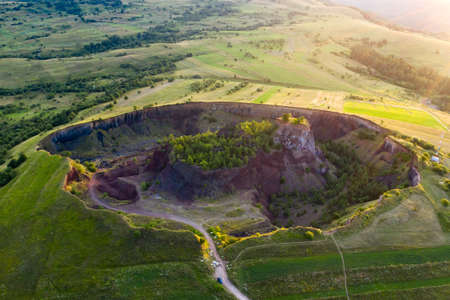 Aerial view of Racos volcanic crater in the sunrise, Brasov county, Romania