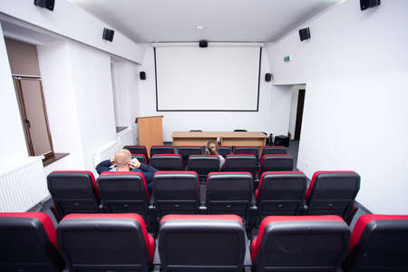 Cinema hall with empty screen. Concept of recreation and entertainment