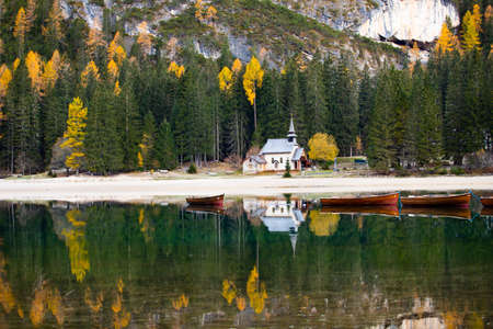 Amazing view of Lago di Braies, one of the most beautiful lake in South Tirol, Dolomites mountains, Italy. Popular tourist attraction.