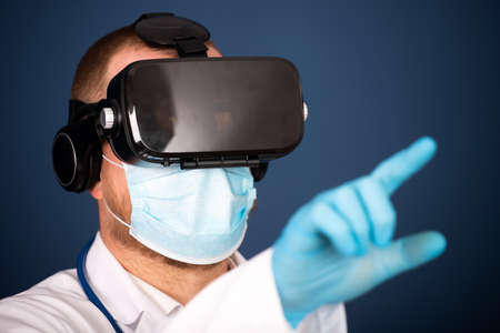 VR medicine. Doctor using virtual reality headset for medical purposes.