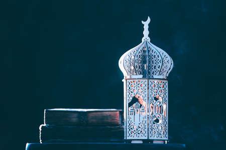 Ornamental Arabic lantern with with Holy Quran. Festive greeting card for Muslim holy month Ramadan Kareem. Stockfoto