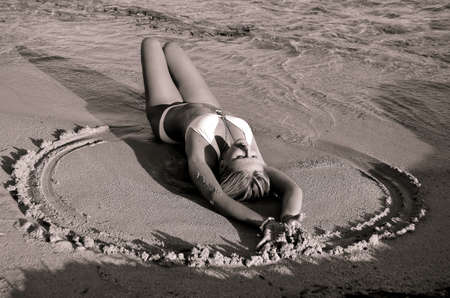 model posing lying in the sand