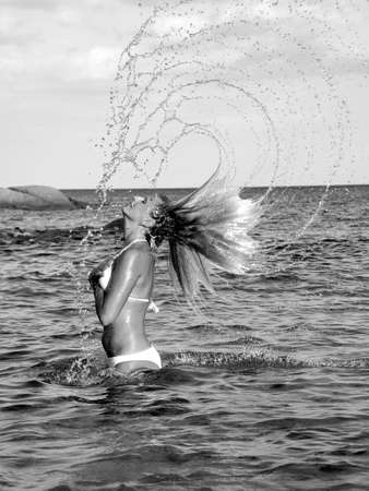 girl makes splash with hair Stock Photo
