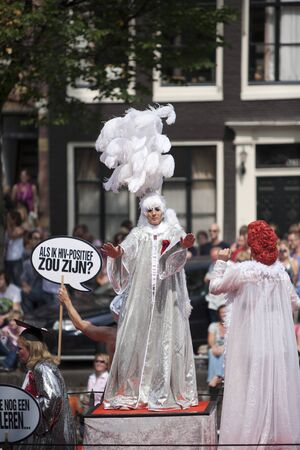 canal parade: AMSTERDAM, THE NETHERLANDS - AUGUST 6, 2011: Gay people dancing at the famous Canal Parade of the Amsterdam Gay Pride 2011 with spectators in the background.
