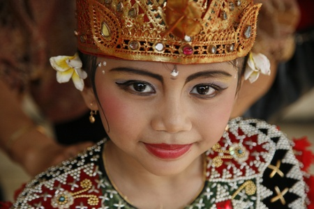 JAKARTA, INDONESIA - JULY 23, 2006: Young Balinese dancer is posing after performing her traditional Balinese dance on July 23, 2006 in Jakarta. Editorial