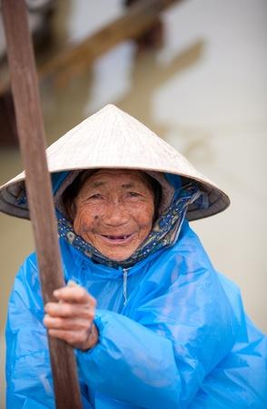 HOI AN, VIETNAM - DECEMBER 17, 2011: Unidentified Vietnamese old woman in Hoi An, december 17, 2011 in Vietnam.