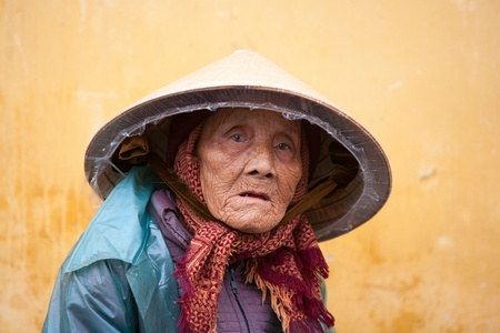 HOI AN, VIETNAM - DECEMBER 20, 2011: Unidentified Vietnamese old woman in Hoi An, december 20, 2011 in Vietnam.