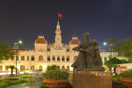 vietnam flag: Peoples Committee building at night in Ho Chi Minh City, Vietnam