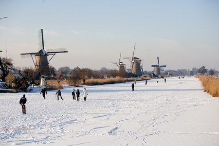 KINDERDIJK - FEBRUARY 4, 2012: Start of the skating period in the Netherlands at the Dutch historic windmills in Kinderdijk, february 4, 2012 in the Netherlands