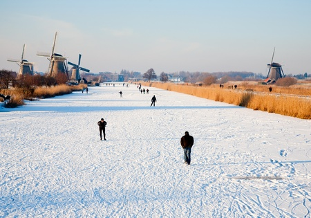 KINDERDIJK - FEBRUARY 4, 2012: Start of the skating period in the Netherlands at the Dutch historic windmills in Kinderdijk, february 4, 2012 in the Nethelands Stock Photo - 12679743