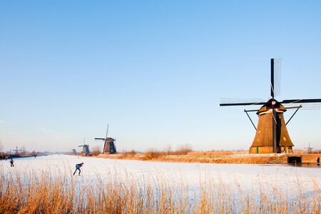 KINDERDIJK - FEBRUARY 4, 2012: Start of the skating period in the Netherlands at the Dutch historic windmills in Kinderdijk, february 4, 2012 in the Netherlands Stock Photo - 12689955