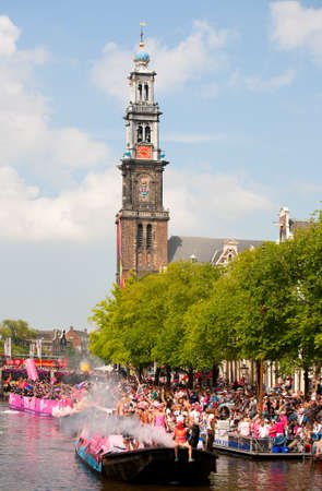westerkerk: AMSTERDAM, THE NETHERLANDS - AUGUST 4, 2012: Participants dance in front of spectators at the famous Canal Parade of the Amsterdam Gay Pride 2012 on August 4, 2012 in Amsterdam