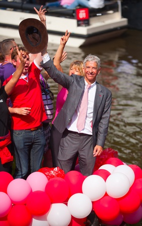 canal parade: AMSTERDAM, THE NETHERLANDS - AUGUST 4, 2012: Politician Ronald Plassterk and other participants in front of spectators at the famous Canal Parade of the Amsterdam Gay Pride 2012 on August 4, 2012 in Amsterdam Editorial