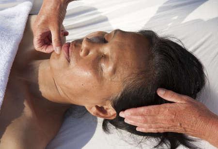 restore energy flow: Japanese facial massage Stock Photo