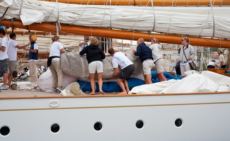 cleaning crew: CANNES, FRANCE - SEPTEMBER 28, 2012: Unidentified crew members in the harbor after the 34th edition of the Regates Royales - Panerai Trophy 2012 on September 28 , 2012 in Cannes Editorial