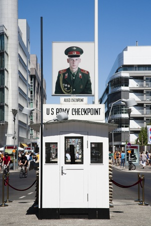 allied: BERLIN, GERMANY - JULY 21, 2013  Checkpoint Charlie; the most famous Berlin crossing point between East and West Berlin during the Cold War Editorial