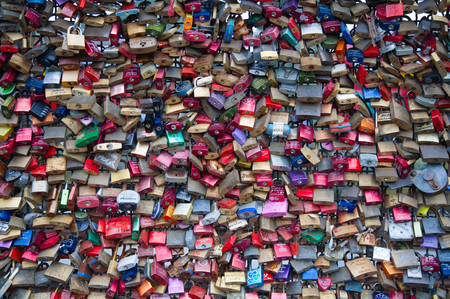 symbolize: COLOGNE, GERMANY - MAY 29, 2014, Thousands of love locks which sweethearts lock to the Hohenzollern Bridge to symbolize their love on May 29 in Koln, Germany
