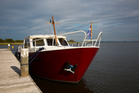 Dutch motorboat moored at the Alkmaardermeer Lake