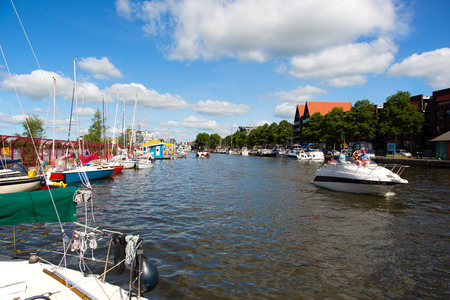 Sneek, Friesland, The Netherlands - August 5, 2018; Ships are anchored at the Sneek Marina during the Sneekweek 2018 in Sneek, Friesland, the Netherlands