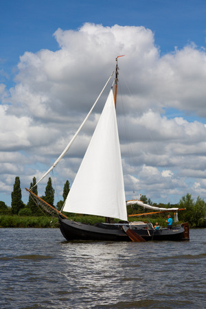 Heeg, Friesland, The Netherlands - August 5, 2018; Dutch traditional ship is sailing near Heeg, Friesland, The Netherlands