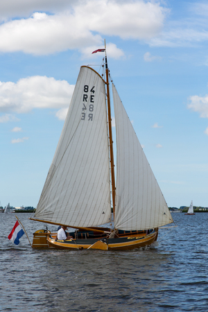 Sneek, Friesland, The Netherlands - August 5, 2018; Dutch traditional ship is sailing at the Sneek Lake, Friesland, The Netherlands