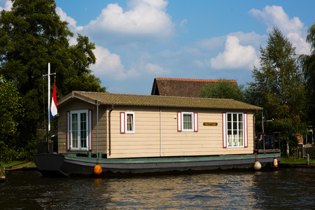 National Park De Alde Feanen, Friesland, The Netherlands - August 21, 2018; House boat on the waterfront for sale, Friesland, The Netherlands