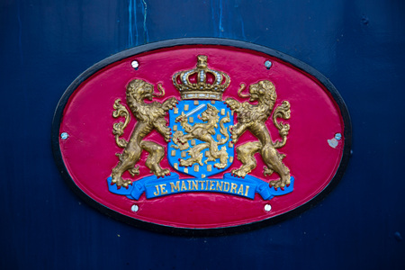 Coat of arms of the Netherlands at the side of an antique train