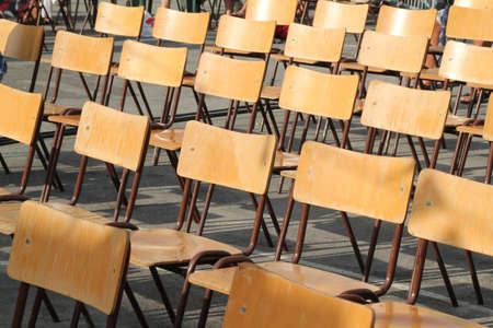 empty classroom: Empty Wooden Chairs at an Outside Event