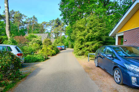 Street at a Bungalowpark parked with cars at recreation park estate Netherlands, opening afther corona lockdown Banque d'images