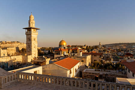 Sunset view old City of Jerusalem from Ecce homo pilgrim house Roof, via Dolorosa street. El-Ghawanima Tower and Al Aqsa Mosque, Dome of the Rock. Stock Photo