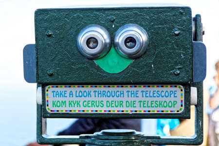 Pay to view telescope at Cape of Good Hope, South Africa, overlooking Cape Point. With Afrikaans text:Kom Kijk Gerus Deur Die Teleskoop