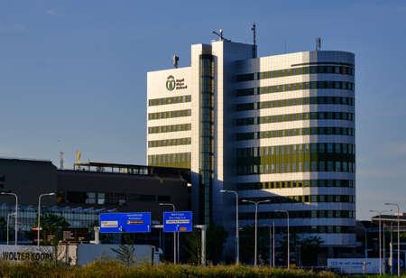 Honselersdijk, the Netherlands,June 24,2020:Main office building Flora Holland flower auction at Honselersdijk, Naaldwijk. With logo text and flags.