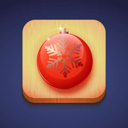 kerstbal rood: Red christmas ball on a wooden stand.