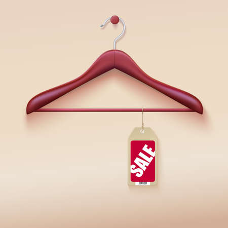 Red tag with sale sign hanging on wooden hanger