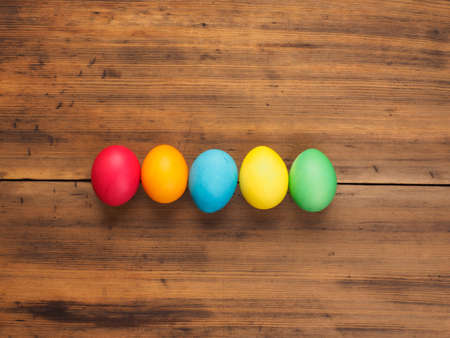 Easter eggs on old brown wood background. Top view, horizontal. Mock up for your greetings card, poster or other design. Russian and Ukrainian, orthodox, slavic traditional Easter, rural background. Stock Photo