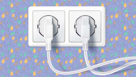 Two white plug inserted in a wall socket on backdrop of wall with colorful wallpaper. The plug is plugged into the power lines with electric cord.