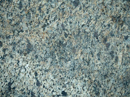 Grey wall made of marble aggregate, close up view. Abstract background. Marble aggregate texture close up. Marble wall pattern